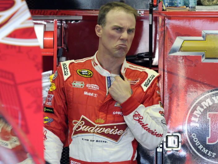 Kevin Harvick reacts as he talks to crew members during a NASCAR Sprint Cup series auto race practice at Darlington Speedway in Darlington, S.C., Friday, April 11, 2014. (AP Photo/Mike McCarn)
