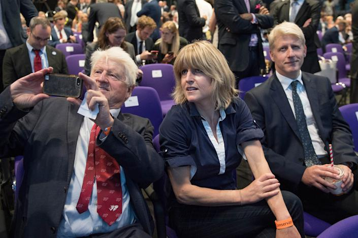 LONDON, ENGLAND - JULY 23: Boris's father Stanley Johnson, sister Rachel Johnson and brother Jo Johnson react after Boris Johnson is elected as the new leader of the Conservative Party and British Prime Minister during the Conservative Leadership announcement at the QEII Centre on July 23, 2019 in London, England. After a month of hustings, campaigning and televised debates the members of the UK's Conservative and Unionist Party have voted for Boris Johnson to be their new leader and the country's next Prime Minister, replacing Theresa May. (Photo by Stefan Rousseau - WPA Pool/Getty Images)