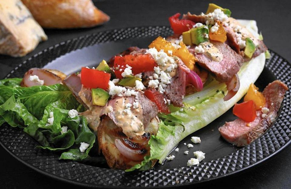 """<p>Steak is good anytime and anywhere, but it especially shines <a href=""""https://www.thedailymeal.com/cook/how-grill-perfect-steak-gallery?referrer=yahoo&category=beauty_food&include_utm=1&utm_medium=referral&utm_source=yahoo&utm_campaign=feed"""" rel=""""nofollow noopener"""" target=""""_blank"""" data-ylk=""""slk:when it's cooked on the grill"""" class=""""link rapid-noclick-resp"""">when it's cooked on the grill</a>. For this recipe, add about one pound of top sirloin steaks to the grill with veggies and potatoes. Serve the ingredients over a bed of lettuce when they're done.</p> <p><a href=""""https://www.thedailymeal.com/recipes/grilled-steak-and-potato-salad-recipe-1?referrer=yahoo&category=beauty_food&include_utm=1&utm_medium=referral&utm_source=yahoo&utm_campaign=feed"""" rel=""""nofollow noopener"""" target=""""_blank"""" data-ylk=""""slk:For the Grilled Steak and Potato Salad recipe, click here"""" class=""""link rapid-noclick-resp"""">For the Grilled Steak and Potato Salad recipe, click here</a>.</p>"""
