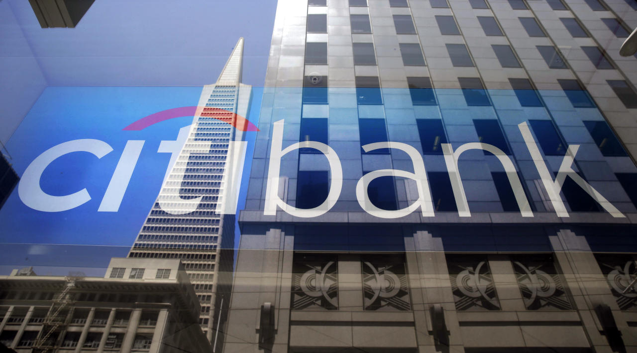 <p> FILE - In this July 9, 2014, file photo, the Transamerica Pyramid is reflected in the window of the main branch of Citibank in the Financial District of San Francisco. Citigroup put new restrictions on firearm sales by its business customers, the bank said Thursday, March 22, 2018, making it the first bank to announce changes to its policies in the wake of the school shooting in Florida. (AP Photo/Eric Risberg, File) </p>