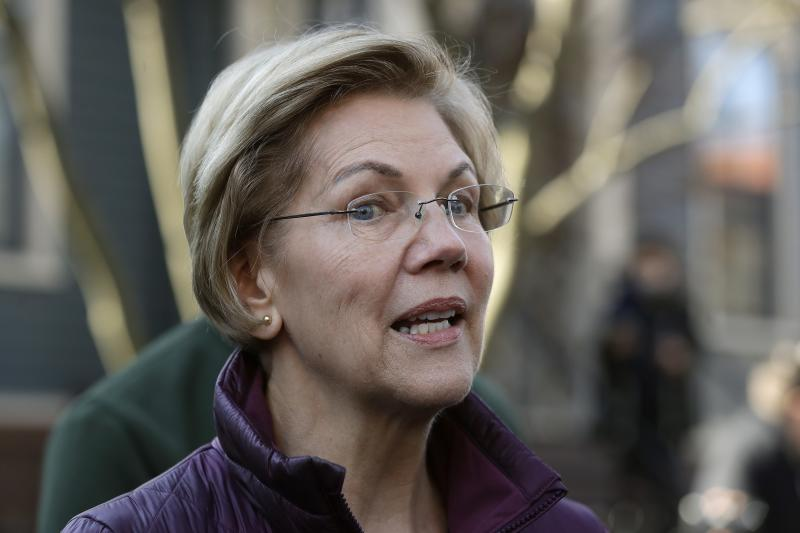FILE - In this Thursday, March 5, 2020, file photo, Sen. Elizabeth Warren, D-Mass., speaks to the media outside her home in Cambridge, Mass., after she dropped out of the Democratic presidential race. Democratic lawmakers are calling out an apparent lack of racial data that they say is needed to monitor and address disparities in the national response to the coronavirus outbreak. Massachusetts Sen. Elizabeth Warren and Rep. Ayanna Pressley say in a letter to Health and Human Services Secretary Alex Azar dated Friday, March 27, 2020, that comprehensive demographic data on people who are tested or treated for the coronavirus does not exist. (AP Photo/Steven Senne, File)