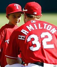 Texas Rangers' outfield Josh Hamilton talks to Cooper Stone, whose dad Shannon died at a game while trying to catch a foul ball