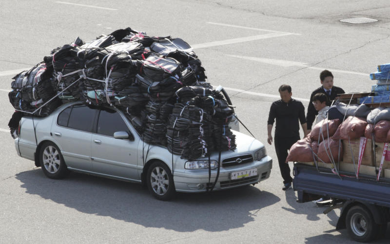 FILE - In this April 27, 2013 file photo, South Korean vehicles, overloaded with finished products, arrive back from North Korea's Kaesong industrial complex at the customs, immigration and quarantine office near the border village of Panmunjom in Paju, South Korea. Pyongyang has also taken an economic hit for its stance. Operations at the Kaesong factory park - a joint endeavor with South Korea just north of the Demilitarized Zone - have been suspended since early April, when the North barred South Korean factory managers and supply trucks from entering and withdrew all its 53,000 workers. (AP Photo/Ahn Young-joon, File)