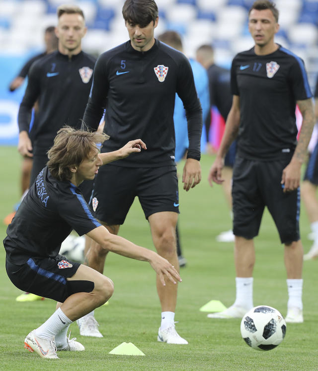Croatia's Luka Modric tries to control a ball during official training on the eve of the group D match between Croatia and Nigeria at the 2018 soccer World Cup in the Kaliningrad Stadium in Kaliningrad, Russia, Friday, June 15, 2018. (AP Photo/Czarek Sokolowski)