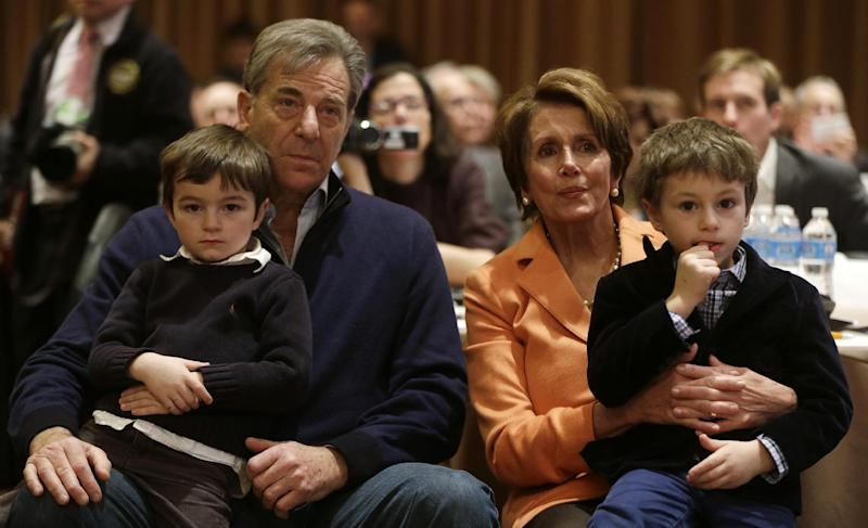 House Minority Leader Nancy Pelosi of Calif., is seated with her husband Paul and unidentified grandchildren as they listen to President Barack Obama speak at the House Democratic Issues Conference in Lansdowne, Va., Thursday, Feb. 7, 2013. (AP Photo/Charles Dharapak)