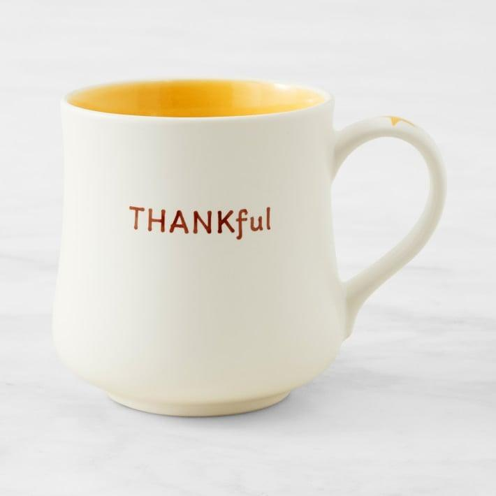 <p>This <span>Williams-Sonoma Thankful Sentiment Mug</span> ($13) is thoughtful reminder to count your blessings and practice gratitude. With the bright yellow interior and joyful message, it will cheer you up any day. </p>