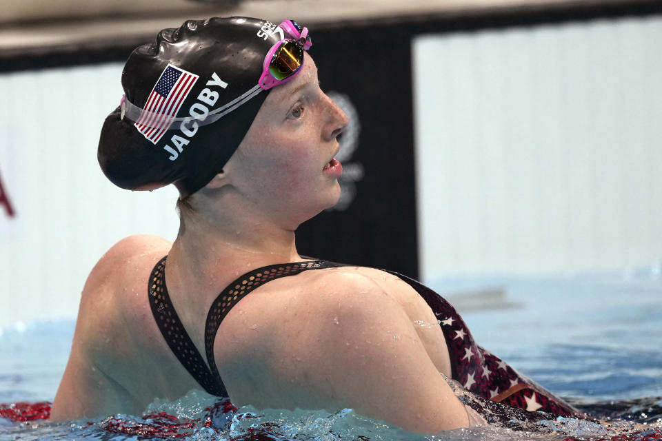 Lydia Jacoby of the United States leans on a lane rope after winning the final of the women's 100-meter breaststroke at the 2020 Summer Olympics, Tuesday, July 27, 2021, in Tokyo, Japan. (AP Photo/Matthias Schrader)