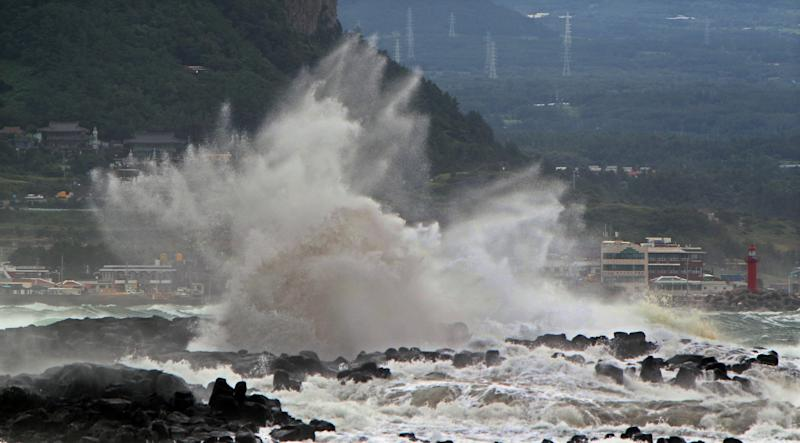 High waves crash on the eastern coast of Jeju Island, South Korea, as Typhoon Bolaven approaches the Korean Peninsula approaches the Korean Peninsula Monday, Aug. 27, 2012. (AP Photo/Yonhap, Kim Ho-cheon) KOREA OUT
