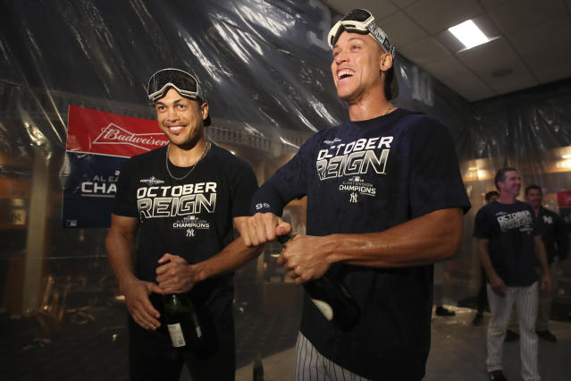 New York Yankees' Giancarlo Stanton, left, and Aaron Judge celebrate after defeating the Los Angeles Angels and clinching the AL East baseball title. (AP Photo/Mary Altaffer)