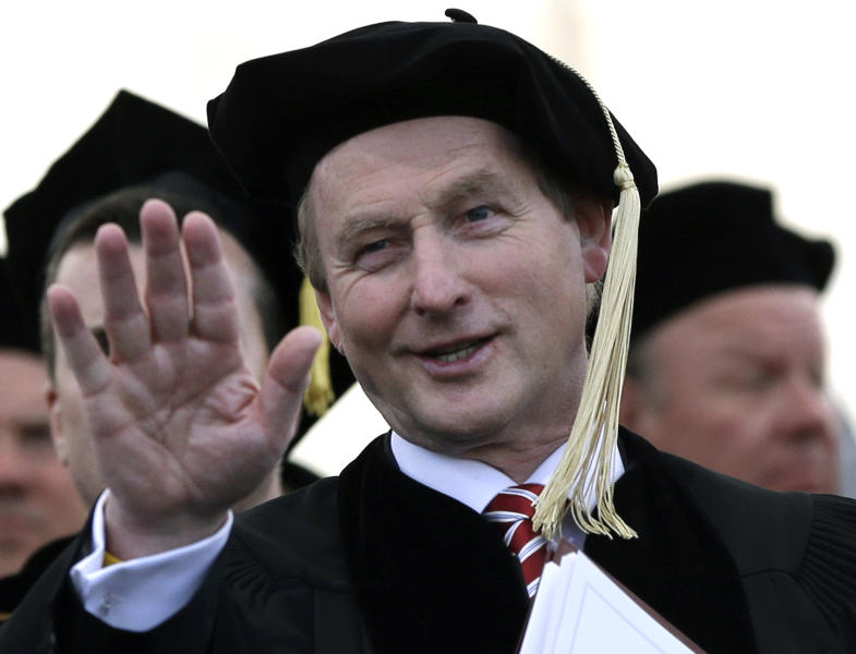 Irish Prime Minister Enda Kenny waves to students from the dais at Boston College where he received an honorary Doctor of Laws degree during commencement ceremonies at Alumni Stadium in Boston, Monday, May 20, 2013. Cardinal Sean O'Malley skipped Boston College's commencement Monday because of the involvement of Kenny, who supports a bill in his country that would allow abortion. The leader of the Boston Archdiocese traditionally gives the benediction at the college's ceremony. (AP Photo/Elise Amendola)