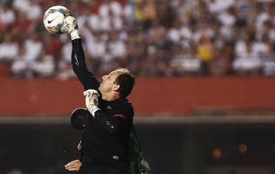 Rogerio Ceni, the highest-scoring goalkeeper in history, charmed the world with his golden boots, but it is his magical gloves that will be most missed at the club where he spent his career, Brazil's Sao Paulo. AFP PHOTO / Miguel SCHINCARIOL (AFP Photo/Miguel Schincariol)