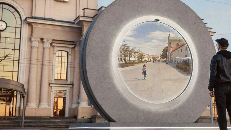A man stares into a portal showing live video of another city.