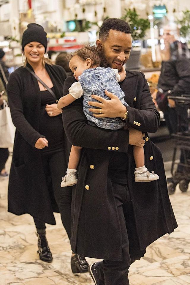 <p>The adorable family shopped for some goodies at the Dean & Deluca store in Manhattan's Soho neighborhood on Monday. Chrissy, who's expecting the couple's second child, a boy, looked lovingly at her hubby who carried their daughter in his arms. (Photo: Backgrid) </p>