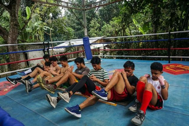 Boxers train for hours a day, often in open-air camps (AFP Photo/DANTE DIOSINA JR)