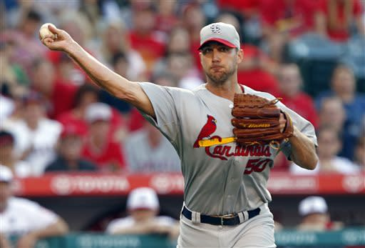 St. Louis Cardinals starting pitcher Adam Wainwright throws out Los Angeles Angels' J.B. Shuck on a sacrifice bunt in the third inning during a baseball game on Thursday, July 4, 2013, in Anaheim, Calif. (AP Photo/Alex Gallardo)