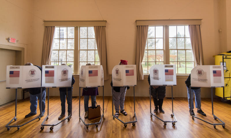 Voters fill out their ballots at the Old Stone School polling location in Hillsboro, Virginia, on Nov. 6. (Bill Clark via Getty Images)