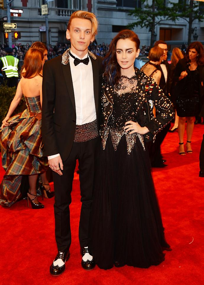 "NEW YORK, NY - MAY 06:  Jamie Campbell Bower and Lily Collins attend the Costume Institute Gala for the ""PUNK: Chaos to Couture"" exhibition at the Metropolitan Museum of Art on May 6, 2013 in New York City.  (Photo by Larry Busacca/Getty Images)"