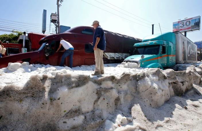 Trucks buried in hail in the eastern area of Guadalajara, Mexico, on June 30. (Photo: Ulisies Ruiz/AFP/Getty Images)