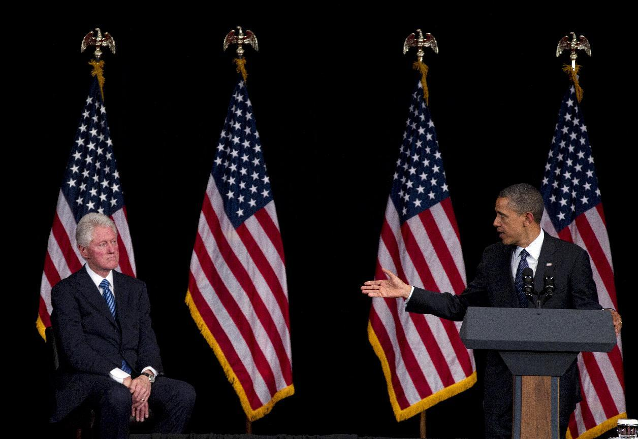 Former President Bill Clinton is acknowledged by President Barack Obama as he speaks during a campaign event at the Waldorf Astoria, Monday, June 4, 2012, in New York. (AP Photo/Carolyn Kaster)
