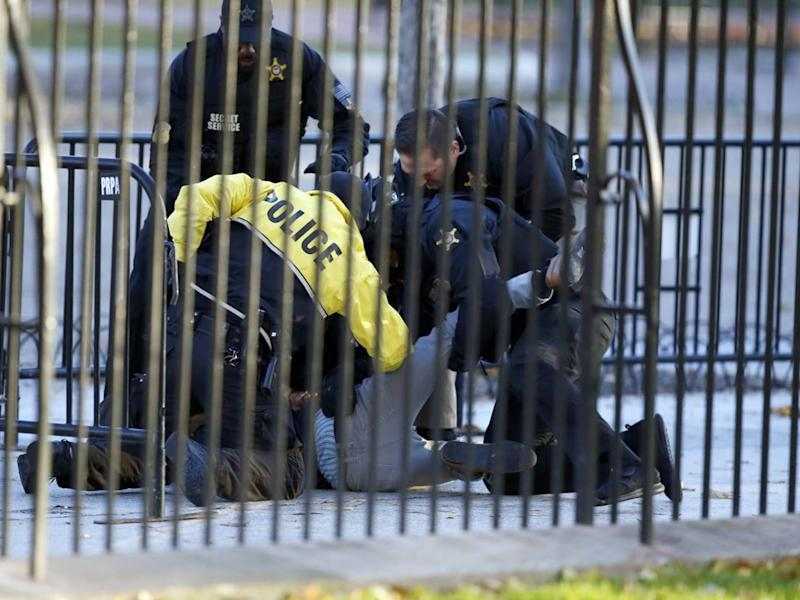 The man is subdued by the Secret Service after leaping the barrier at the White House: AP