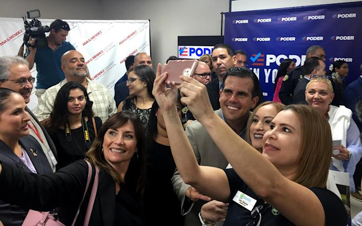 Gov. Ricardo Rosselló of Puerto Rico poses for pictures at Ana G. Mendez University in Orlando, Fla., on April 24. (Video still: Robert Thomas/Yahoo News)