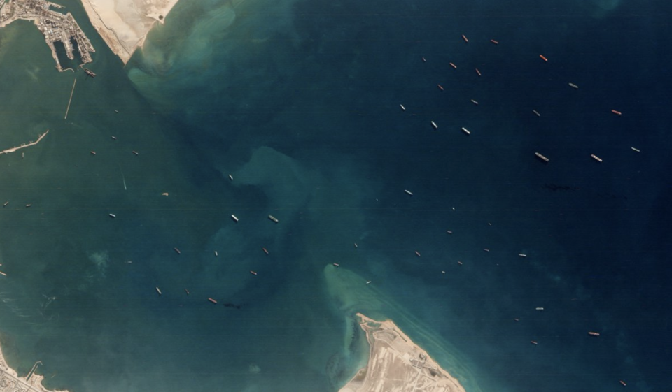 Vessels are seen backed up at the Suez Canal after it was blocked by the Ever Given ship in an aerial photo.