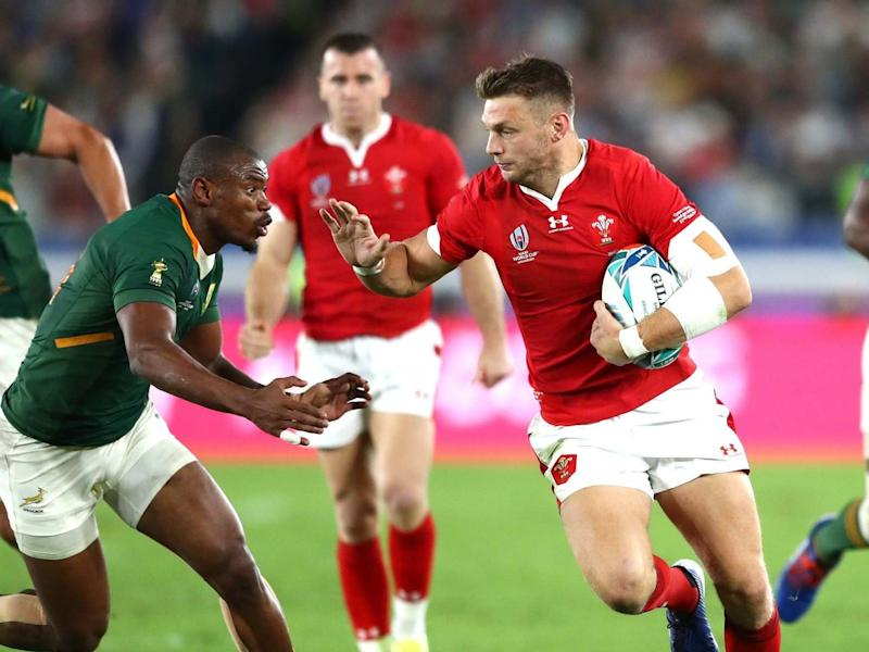 Dan Biggar of Wales (R) fends Makazole Mapimpi of South Africa: Getty Images