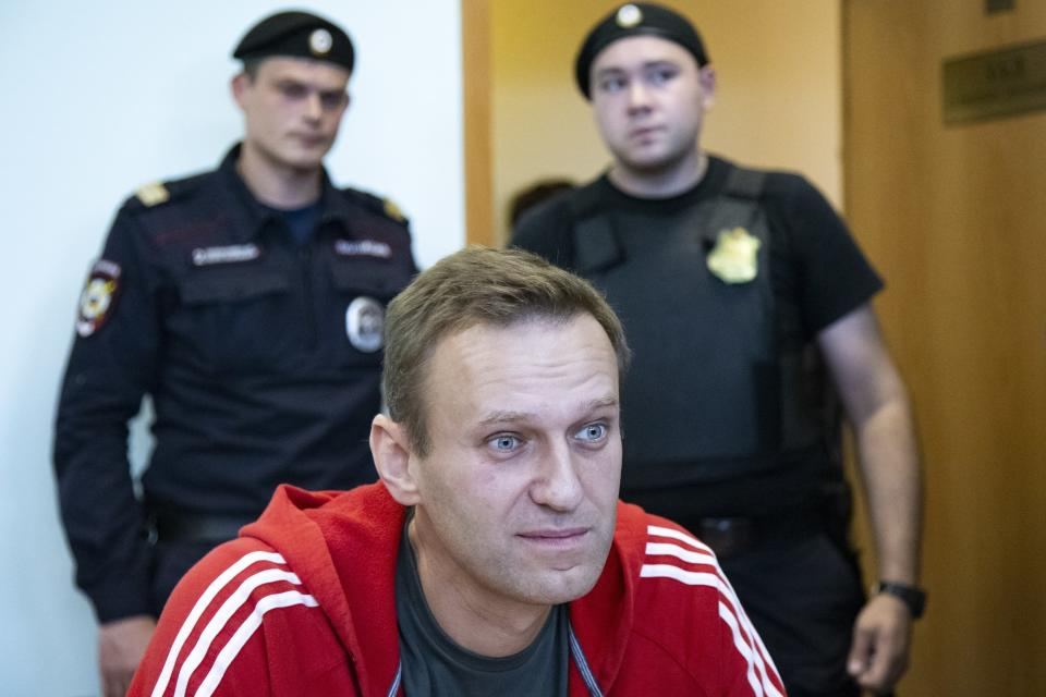 FILE- In this file photo taken on Thursday, Aug. 22, 2019, Russian opposition leader Alexei Navalny speaks to the media prior to a court session in Moscow, Russia. Russia came under renewed pressure to explain the nerve agent attack on opposition figure Alexei Navalny as the annual meeting of the global chemical weapons watchdog got underway in The Hague, Netherlands, Monday Nov. 30, 2020, amid measures aimed at reining in the spread of the coronavirus. (AP Photo/Alexander Zemlianichenko, File)