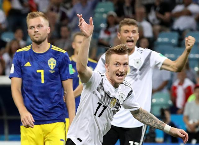 Soccer Football - World Cup - Group F - Germany vs Sweden - Fisht Stadium, Sochi, Russia - June 23, 2018 Germany's Marco Reus celebrates scoring their first goal with Thomas Muller as Sweden's Sebastian Larsson looks dejected REUTERS/Francois Lenoir