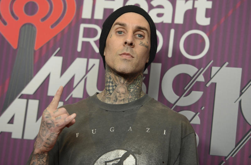 Travis Barker poses in the press room at the iHeartRadio Music Awards on Thursday, March 14, 2019, at the Microsoft Theater in Los Angeles. (Photo by Jordan Strauss/Invision/AP)