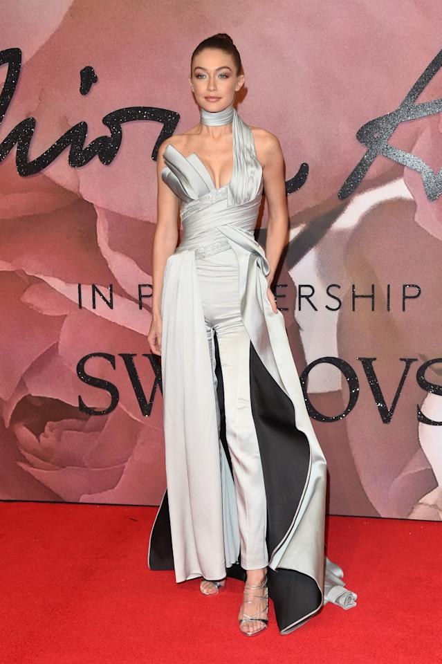 <p>The Model of the Year winner certainly earned her title in a silvery Atelier Versace jumpsuit. <i>[Photo: Getty]</i> </p>