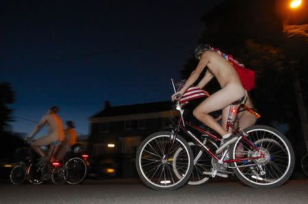 Cyclists pour into the streets of Portland for the 11th annual World Naked Bike Ride June 7, 2014. REUTERS/Steve Dipaola