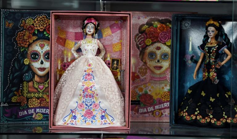 "This year ""Catrina"" Barbie wears a blush-colored lace dress, unlike last year when she was dressed in black"