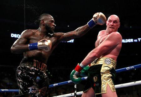 FILE PHOTO: Boxing - Deontay Wilder v Tyson Fury - WBC World Heavyweight Title - Staples Centre, Los Angeles, United States - December 1, 2018 Deontay Wilder in action against Tyson Fury Action Images via Reuters/Andrew Couldridge TPX IMAGES OF THE DAY