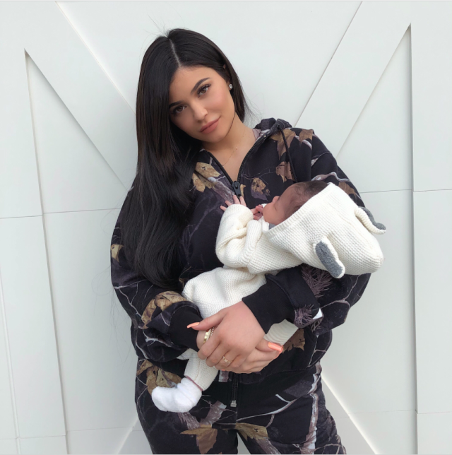 "<p>When her ""angel baby"" turned one month old on March 1, it was time for a photo shoot at Chez Kylie. You could mostly see the lip kit queen, but she cradled her daughter — sporting some cute ears on the hood of her snuggily ensemble — in her arms. (Photo: <a href=""https://www.instagram.com/p/BfzEfy-lK1N/?hl=en&taken-by=kyliejenner"" rel=""nofollow noopener"" target=""_blank"" data-ylk=""slk:Kylie Jenner via Instagram"" class=""link rapid-noclick-resp"">Kylie Jenner via Instagram</a>) </p>"