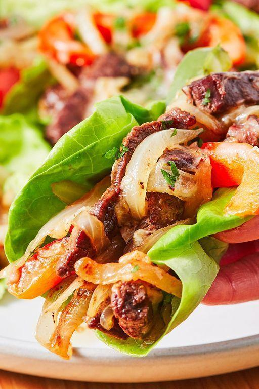 "<p>You will love these low carb Philly Cheesesteak lettuce wraps. And before you get all riled up, no, they're not in any way authentic. We'll be the first to admit it!</p><p>Get the <a href=""https://www.delish.com/uk/cooking/recipes/a32090138/no-carb-philly-cheesesteaks/"" rel=""nofollow noopener"" target=""_blank"" data-ylk=""slk:Philly Cheesesteak Lettuce Wraps"" class=""link rapid-noclick-resp"">Philly Cheesesteak Lettuce Wraps</a> recipe.</p>"