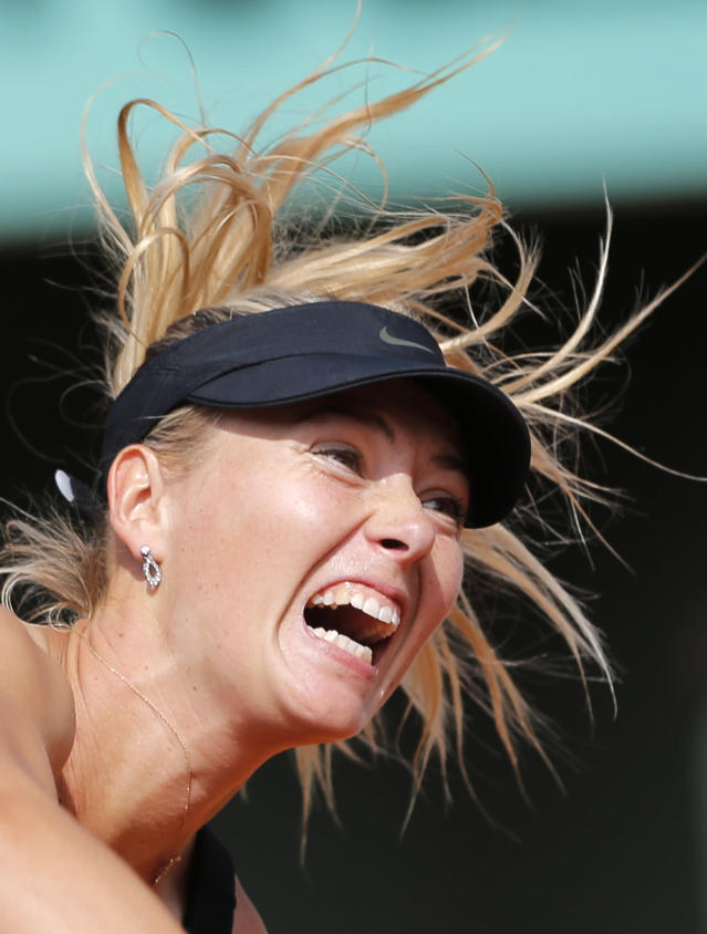 Russia's Maria Sharapova serves the ball to China's Peng Shuai during their third round match in the French Open tennis tournament at the Roland Garros stadium in Paris, Saturday, June 2, 2012. Sharapova won 6-2, 6-1. (AP Photo/Christophe Ena)