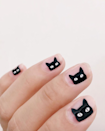 """If this is too hard to DIY, try <a href=""""https://www.walmart.com/ip/SinfulColors-Claws-Halloween-Press-On-Nails-Cat-Call/919211790?selected=true"""" rel=""""nofollow noopener"""" target=""""_blank"""" data-ylk=""""slk:these press-ons"""" class=""""link rapid-noclick-resp"""">these press-ons</a> from SinfulColors for a similar look."""