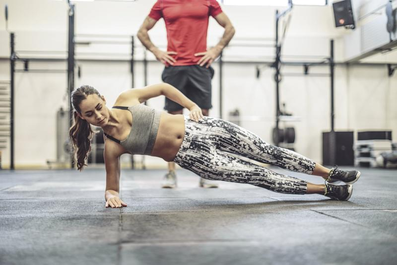 Young couple is doing cross training exercise together