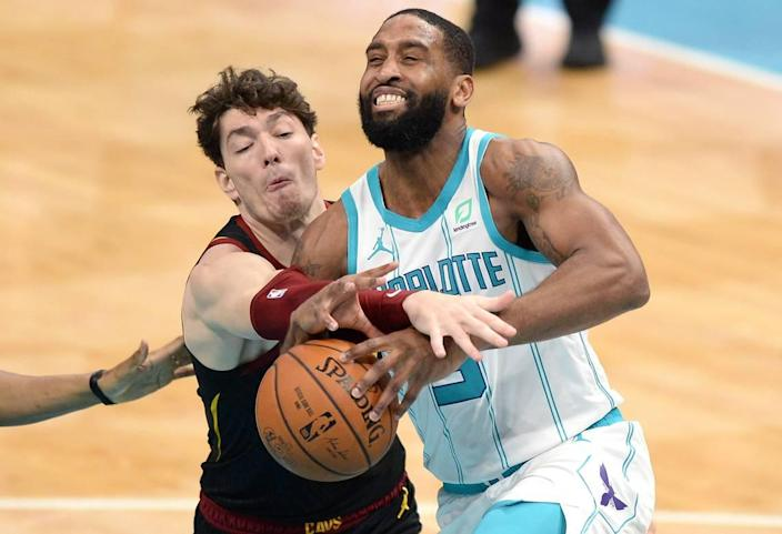 Charlotte Hornets guard Brad Wanamaker, right, is fouled by Cleveland Cavaliers forward Cedi Osman, left, on a drive to the basket Wednesday. Wanamaker scored nine points off the bench for the Hornets in the 103-90 loss.