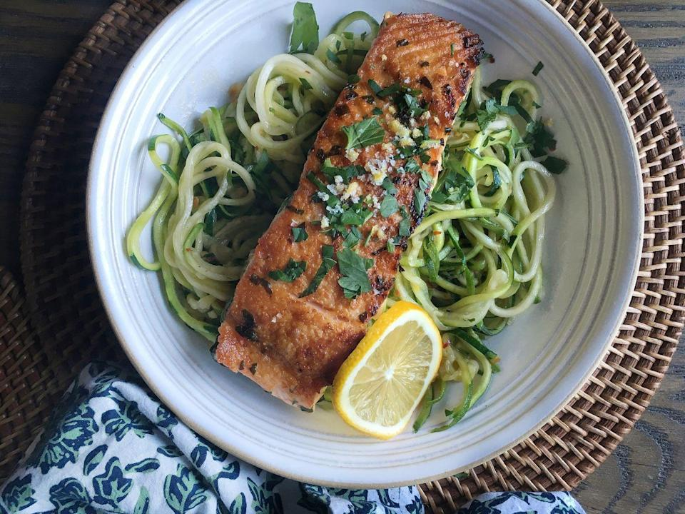 """<p>Ditch the carbs and prepare to be obsessed with these garlicky zucchini noodles.</p><p>Get the recipe from <a href=""""/cooking/recipe-ideas/recipes/a46065/seared-salmon-with-garlicky-zucchini-noodles/"""" data-ylk=""""slk:Delish"""" class=""""link rapid-noclick-resp"""">Delish</a>.</p>"""