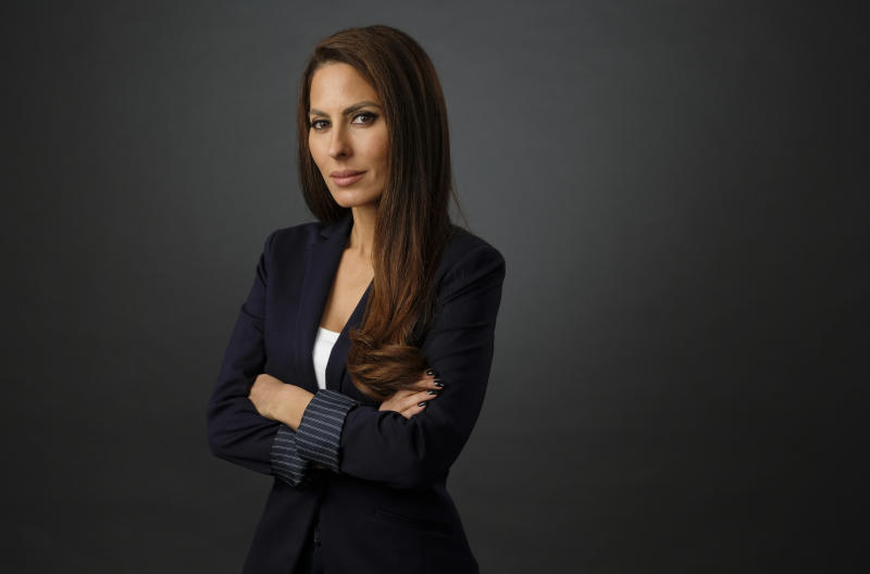 """FILE - In this June 20, 2018 file photo, Kerri Kasem, daughter of the late disc jockey Casey Kasem, poses for a portrait, in Los Angeles. Family members of radio personality Casey Kasem have settled a lawsuit against his widow that alleged her neglect and physical abuse led to his death in 2014. Kerri Kasem, one of Kasem's daughters who filed the lawsuit, released a statement through a spokesman Tuesday saying she was """"distraught and heartbroken over her family and lawyers' decision to force her into a settlement."""" (Photo by Chris Pizzello/Invision/AP, File)"""