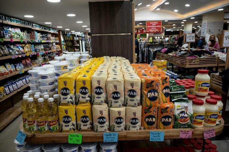Prices on many shop shelves are displayed in US dollar, to keep things simpler (AFP/Yuri CORTEZ)
