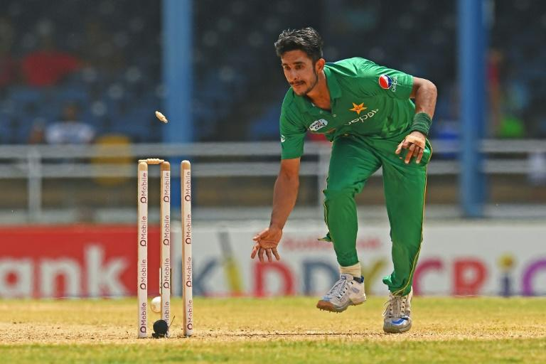 Pakistan's Hasan Ali runs out West Indies' Lendl Simmons at the Queen's Park Oval in Port of Spain, Trinidad, on April 2, 2017