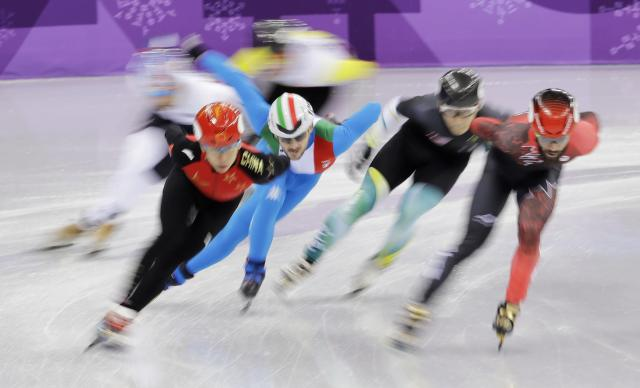 Charles Hamelin of Canada leads the field during the men's 1500 meters on Saturday. (AP)