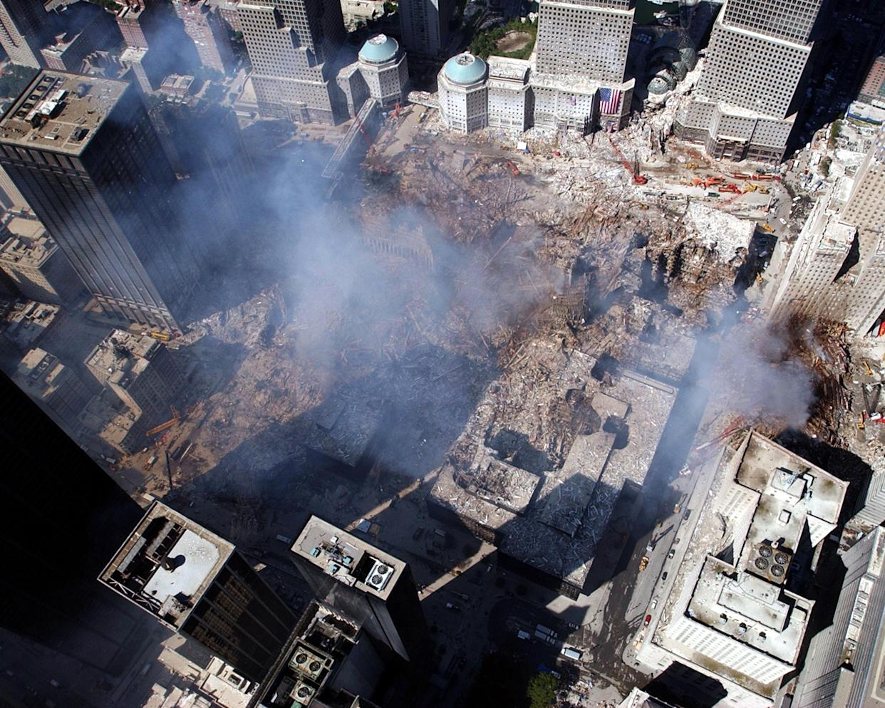 An aerial view shows only a small portion of the crime scene where the World Trade Center collapsed following the Sept. 11 terrorist attack.  Surrounding buildings were heavily damaged by the debris and massive force of the falling twin towers.   (Photo Credit: U.S. Navy/Eric J. Tilford)