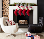 """<p>One of the easiest ways to instantly spruce up your <a href=""""https://www.countryliving.com/home-design/decorating-ideas/advice/g1247/holiday-decorating-1208/"""" rel=""""nofollow noopener"""" target=""""_blank"""" data-ylk=""""slk:holiday decorations"""" class=""""link rapid-noclick-resp"""">holiday decorations</a> is to hang personalized Christmas stockings from your <a href=""""https://www.countryliving.com/home-design/decorating-ideas/g1571/holiday-mantels/"""" rel=""""nofollow noopener"""" target=""""_blank"""" data-ylk=""""slk:mantel"""" class=""""link rapid-noclick-resp"""">mantel</a> (or buy a pretty <a href=""""https://www.countryliving.com/shopping/g4758/stocking-holders/"""" rel=""""nofollow noopener"""" target=""""_blank"""" data-ylk=""""slk:stocking holder"""" class=""""link rapid-noclick-resp"""">stocking holder</a> instead!). Each member of the family will love having their own customized stocking to hold their goodies in (and yes, you can definitely buy <a href=""""https://www.countryliving.com/life/kids-pets/g4752/dog-christmas-stockings/"""" rel=""""nofollow noopener"""" target=""""_blank"""" data-ylk=""""slk:dog Christmas stockings"""" class=""""link rapid-noclick-resp"""">dog Christmas stockings</a> too so your pup isn't left out of the fun!). Not only do stockings serve as a beautiful focal point of the room in which they're hung, or they can blend right in seamlessly depending on which style you choose. They can also enhance your decor and they're an easy way to surprise children, siblings, and other relatives who are coming home for Christmas, or who haven't visited in a while. Personalized Christmas stockings can be as affordable or splurge-worthy as you want them to be, and they're such a simple way to spread joy during the season. They make great gifts, too! Fill them with a few small items or bones and treats for the pups, and you'll bring a lot of smiles to many faces. </p><p>We're certain that you can also find a choice that suits your style or decorating aesthetic. Our top picks (that you can buy right now) range from one-of-a-kind custom patterns t"""
