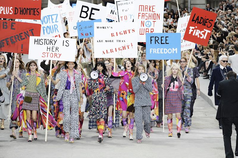 "To set the scene of what he intended as a ""feminist"" protest, Lagerfeld handed models signs emblazoned with slogans like ""history is her story"" and ""ladies first."" However pure his sentiment may have been, the move did not go over well, prompting many to criticize Lagerfeld of attempting to co-opt a serious and timely political movement."