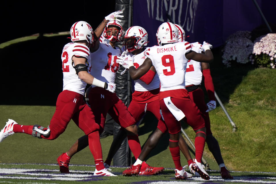 Nebraska defensive back Myles Farmer, second from left, celebrates with teammates after Farmer intercepted a pass during the first half of an NCAA college football game against Northwestern in Evanston, Ill., Saturday, Nov. 7, 2020. (AP Photo/Nam Y. Huh)