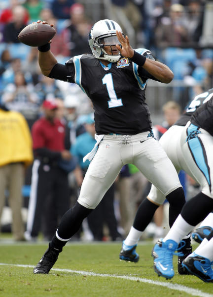 Carolina Panthers' Cam Newton (1) looks to pass against the Atlanta Falcons during the first half of an NFL football game in Charlotte, N.C., Sunday, Dec. 9, 2012. (AP Photo/Bob Leverone)